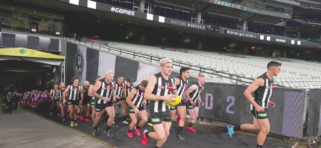 Australian Football League resumes with a thriller and anti-racism protest