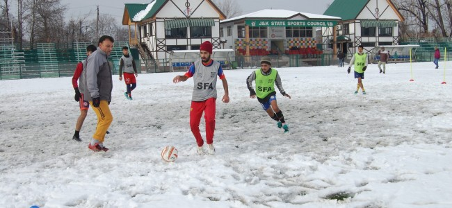 Soccer in snowfall, youngsters enjoying the play at TRC