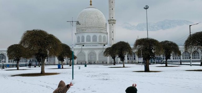 After snowfall, Hazratbal shrine, shines in white