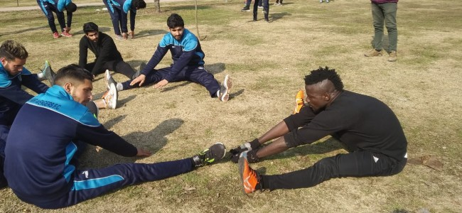 As the sun shines, footballers start practice in Srinagar