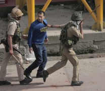 Youth arrested during clashes at city centre.Pic: Mudasir Khan