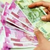 Rupee falls to record low of 71.10 against US dollar